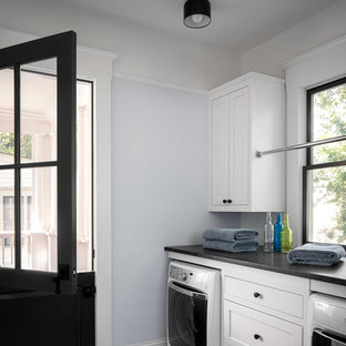 This is an example of a large classic separated utility room in Atlanta with shaker cabinets, white cabinets, engineered stone countertops, blue walls, ceramic flooring, a side by side washer and dryer, black worktops and multi-coloured floors.