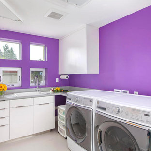 Photo of a large contemporary l-shaped separated utility room in San Diego with a built-in sink, flat-panel cabinets, white cabinets and purple walls.