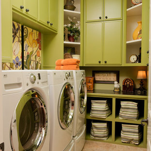 Inspiration for an eclectic beige floor laundry room remodel in Little Rock with green cabinets