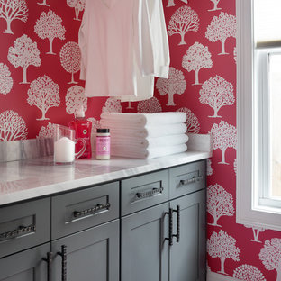 Inspiration for a mid-sized transitional galley porcelain floor dedicated laundry room remodel in Atlanta with shaker cabinets, gray cabinets, marble countertops and red walls