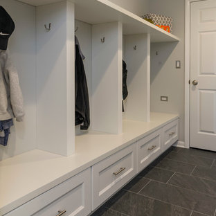 Utility room - mid-sized transitional galley medium tone wood floor utility room idea in Chicago with an undermount sink, flat-panel cabinets, white cabinets, quartz countertops, beige backsplash, glass tile backsplash and gray walls