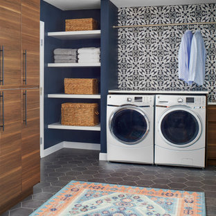 Inspiration for a large scandinavian galley slate floor and gray floor utility room remodel in Denver with flat-panel cabinets, medium tone wood cabinets, solid surface countertops, multicolored walls, a side-by-side washer/dryer and white countertops