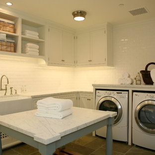 Example of a classic laundry room design in Los Angeles with a farmhouse sink and white countertops