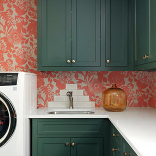 Small beach style l-shaped dedicated laundry room photo in Minneapolis with green cabinets, quartzite countertops, multicolored walls, white countertops, an undermount sink and shaker cabinets