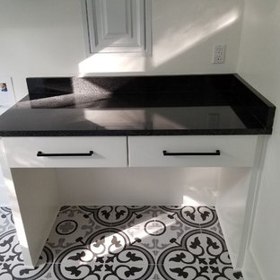 Design ideas for a medium sized coastal single-wall separated utility room in Other with a submerged sink, flat-panel cabinets, white cabinets, granite worktops, white walls, ceramic flooring, a side by side washer and dryer and black worktops.