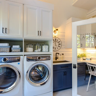 Photo of a large modern l-shaped utility room in Other with a submerged sink, shaker cabinets, blue cabinets, engineered stone countertops, white walls, porcelain flooring, an integrated washer and dryer, white floors and white worktops.