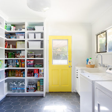 Colorful Laundry Room with Custom Cabinets & Yellow Door