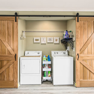 Photo of a large country laundry room in Columbus with a farmhouse sink, recessed-panel cabinets, white cabinets, quartzite benchtops, white splashback, laminate floors, grey floor and white benchtop.