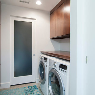 Inspiration for a mid-sized modern galley concrete floor dedicated laundry room remodel in Columbus with flat-panel cabinets, wood countertops, white walls, a side-by-side washer/dryer and dark wood cabinets