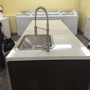 Example of a minimalist laundry room design in Toronto