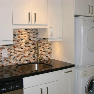 Small contemporary l-shaped laundry room in Miami with an undermount sink, shaker cabinets, white cabinets, granite benchtops, multi-coloured splashback, mosaic tile splashback and slate floors.