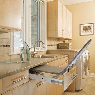 Trendy laundry room photo in Toronto with gray countertops