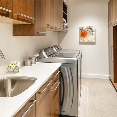 Trendy beige floor laundry room photo in Vancouver with an undermount sink and white countertops