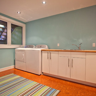 Laundry room - contemporary cork floor laundry room idea in Toronto with wood countertops and beige countertops