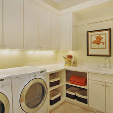 Contemporary Laundry Room by Erotas Building Corporation