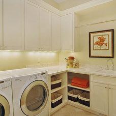 Contemporary Laundry Room by Erotas Building Corporation