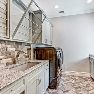 Inspiration for a mid-sized transitional galley porcelain tile and multicolored floor laundry room remodel in Tampa with an undermount sink, recessed-panel cabinets, gray cabinets, granite countertops, gray walls, a side-by-side washer/dryer and multicolored countertops