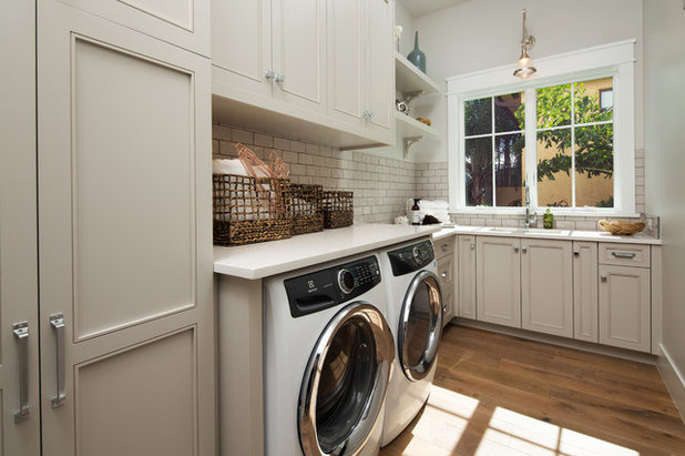 Beach Style Laundry Room by Lotus Construction, LLC.