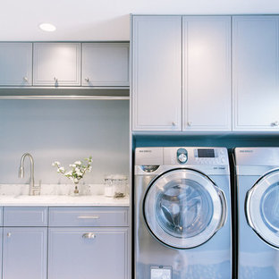 Inspiration for a classic utility room in Portland Maine with recycled glass countertops, porcelain flooring and grey cabinets.