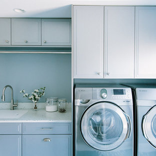 Inspiration for a transitional porcelain tile laundry room remodel in Portland Maine with recycled glass countertops and gray cabinets