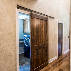 Traditional Laundry Room by Monticello Homes & Development