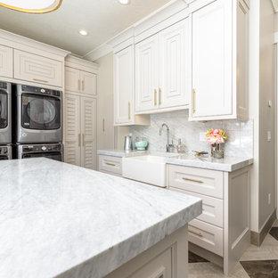 Esempio di una grande sala lavanderia chic con lavello stile country, ante con riquadro incassato, ante beige, pareti beige, lavatrice e asciugatrice a colonna, pavimento multicolore, top bianco e top in marmo
