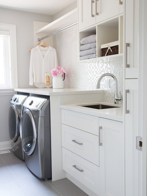 example of a transitional gray floor dedicated laundry room design in toronto with an undermount sink - Laundry Design Ideas