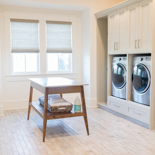 Coastal galley beige floor dedicated laundry room photo in Charleston with an undermount sink, shaker cabinets, beige cabinets, white walls and beige countertops
