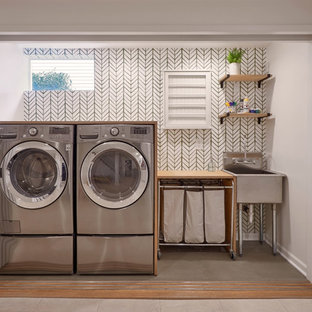 Example of a mid-sized transitional single-wall concrete floor and green floor laundry closet design in Seattle with an utility sink, wood countertops and white walls