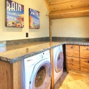 Idee per una piccola sala lavanderia rustica con ante lisce, ante in legno scuro, top in granito, pareti beige, pavimento con piastrelle in ceramica, lavatrice e asciugatrice affiancate, pavimento beige e top grigio