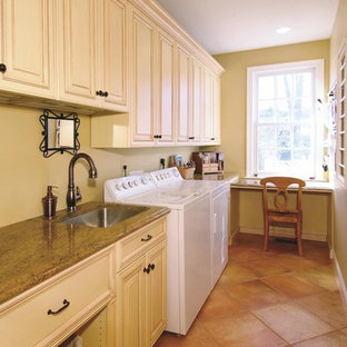 Elegant Pink Floor Laundry Room Photo In Dc Metro With White Cabinets