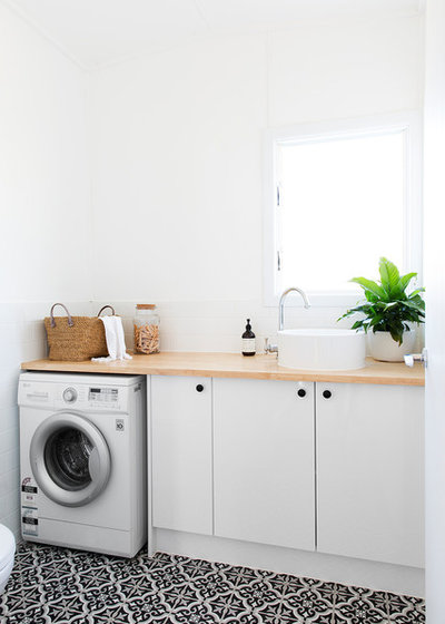 Beach Style Laundry Room by The Design Villa