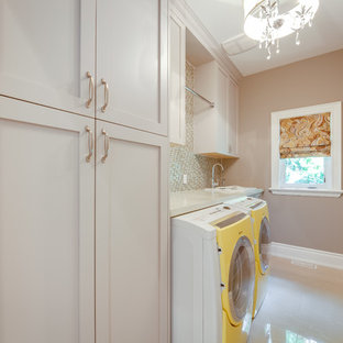 Example of a trendy laundry room design in Toronto