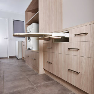 Design ideas for a large contemporary single-wall separated utility room in Other with a built-in sink, flat-panel cabinets, light wood cabinets, laminate countertops, white walls, ceramic flooring, grey floors and multicoloured worktops.