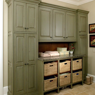 Inspiration for a large traditional galley utility room in Chicago with raised-panel cabinets, green cabinets, granite worktops, beige walls and travertine flooring.