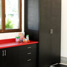 Modern Laundry Room by Valet Custom Cabinets & Closets