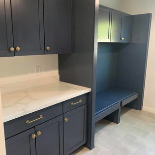 Mid-sized trendy galley porcelain tile and gray floor utility room photo in Phoenix with an undermount sink, shaker cabinets, black cabinets, quartzite countertops, gray walls, a side-by-side washer/dryer and white countertops
