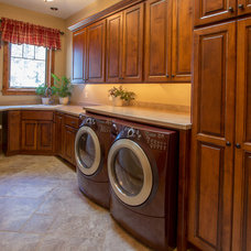 Rustic Laundry Room by Mostad Construction,Inc