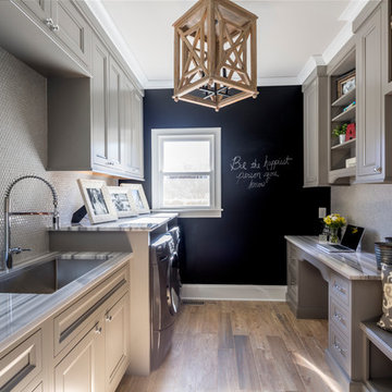 Customized Laundry/Mud Room with Desk, Utility Sink, and Storage Solutions