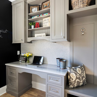 Photo of a mid-sized transitional single-wall utility room in Charlotte with recessed-panel cabinets, grey cabinets, marble benchtops, grey walls and dark hardwood floors.