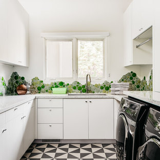 Dedicated laundry room - mid-sized transitional u-shaped multicolored floor dedicated laundry room idea in San Francisco with an undermount sink, flat-panel cabinets, white cabinets and white walls