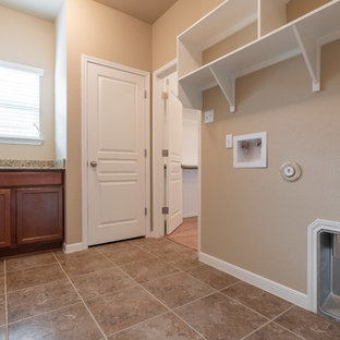 Inspiration for a mid-sized timeless l-shaped ceramic floor and beige floor dedicated laundry room remodel in Austin with open cabinets, white cabinets, granite countertops, beige walls, a side-by-side washer/dryer and beige countertops