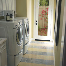 Mediterranean Laundry Room by Andrew Lauren Interiors