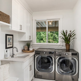 Transitional l-shaped white floor dedicated laundry room photo in Portland with an undermount sink, recessed-panel cabinets, white cabinets, white walls, a side-by-side washer/dryer and beige countertops