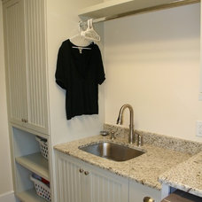 laundry room by Distinctive Cabinets