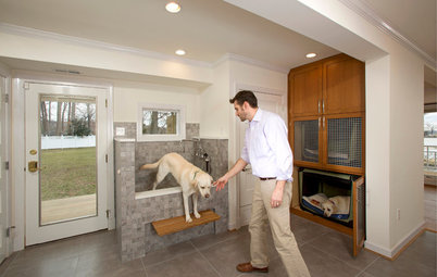 A Laundry Room With Bunk Beds and a Shower for Muddy Dogs