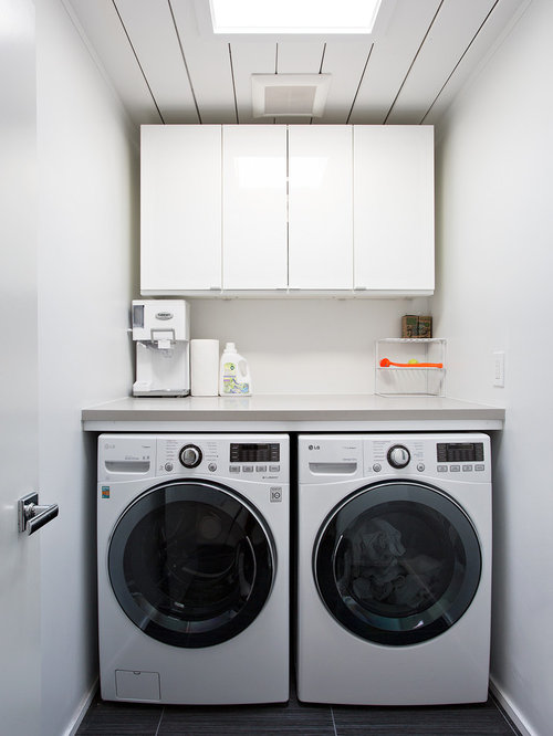inspiration for a small 1950s singlewall black floor dedicated laundry room remodel in san