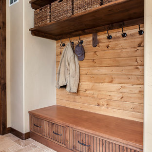 Inspiration for a large classic galley utility room in Denver with a submerged sink, beaded cabinets, medium wood cabinets, granite worktops, beige walls, porcelain flooring, a side by side washer and dryer and beige floors.