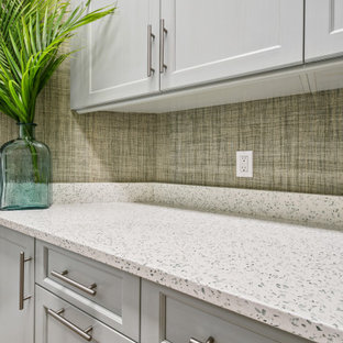 Large island style u-shaped light wood floor and brown floor laundry room photo in Other with an undermount sink, beaded inset cabinets, white cabinets, quartzite countertops, glass tile backsplash and beige countertops