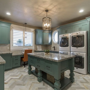 Large country u-shaped ceramic floor utility room photo in Salt Lake City with a single-bowl sink, shaker cabinets, granite countertops, gray walls and a stacked washer/dryer